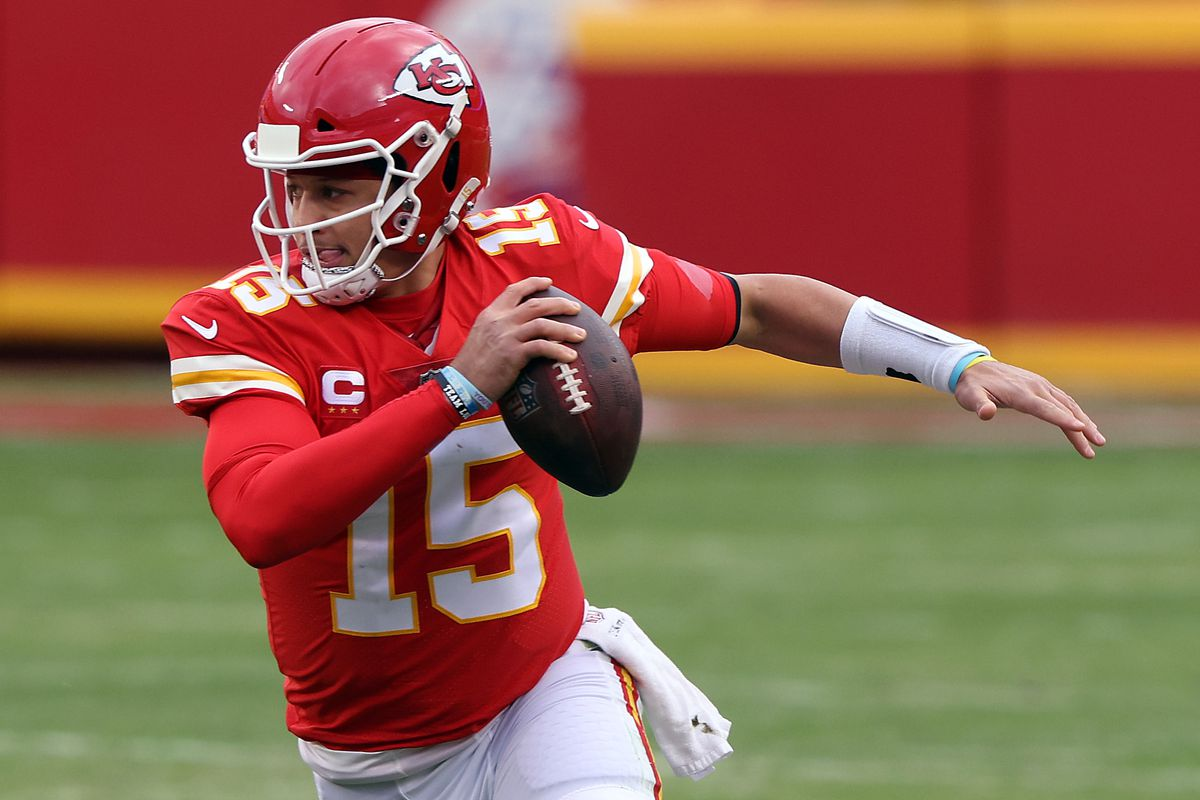 Quarterback Patrick Mahomes #15 of the Kansas City Chiefs scrambles during the AFC Divisional Playoff game against the Cleveland Browns at Arrowhead Stadium on January 17, 2021 in Kansas City, Missour