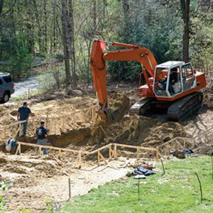 <p><strong>1. Excavating</strong><br>The digging is easy as long as it's dirt, but as it nears the bottom, the excavator strikes ledge, aka solid rock. So into the hole goes a hydraulic rock splitter for a day of chipping and breaking. When all is done, some 150 cubic yards of dirt and rock are taken out, half of which is used for backfilling and grading. The rest is hauled away.</p>