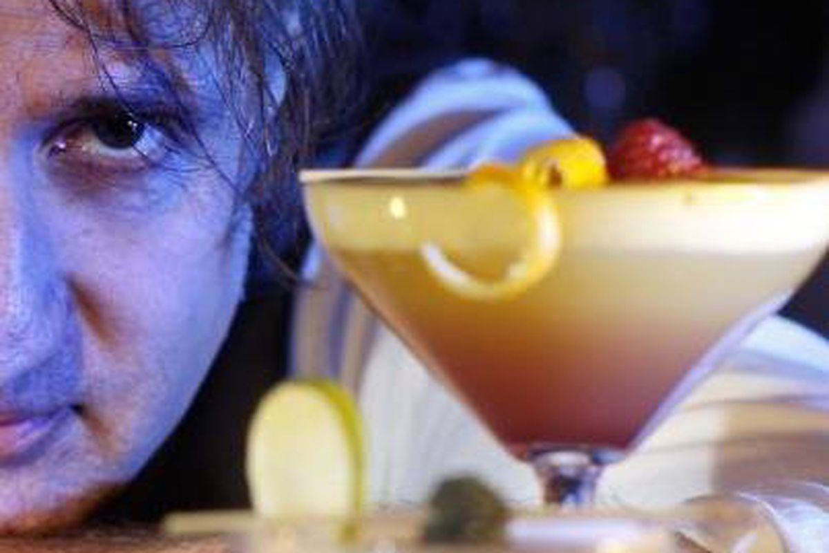 Johnny Michaels mixing up holiday beverages in White Bear Lake