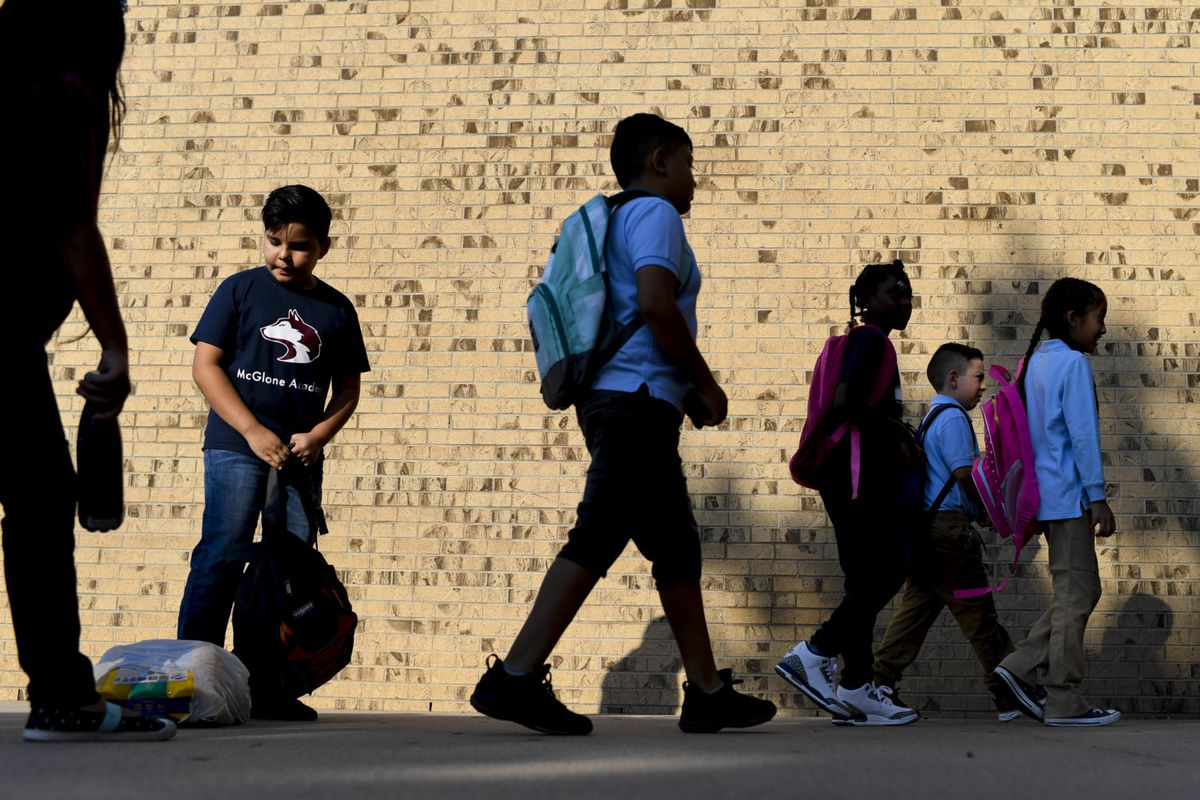 Students enter the building on the first day of school at Denver's McGlone Academy on Wednesday, August 15, 2018. (Photo by AAron Ontiveroz/The Denver Post via Getty Images)