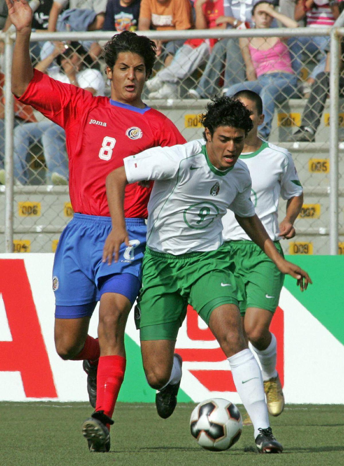 Mexican soccer player Carlos Vela (R) an