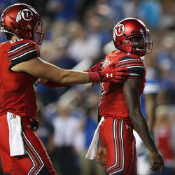 Utah Utes quarterback Tyler Huntley (1) scores against Brigham Young Cougars  in Provo on Saturday, Sept. 9, 2017.