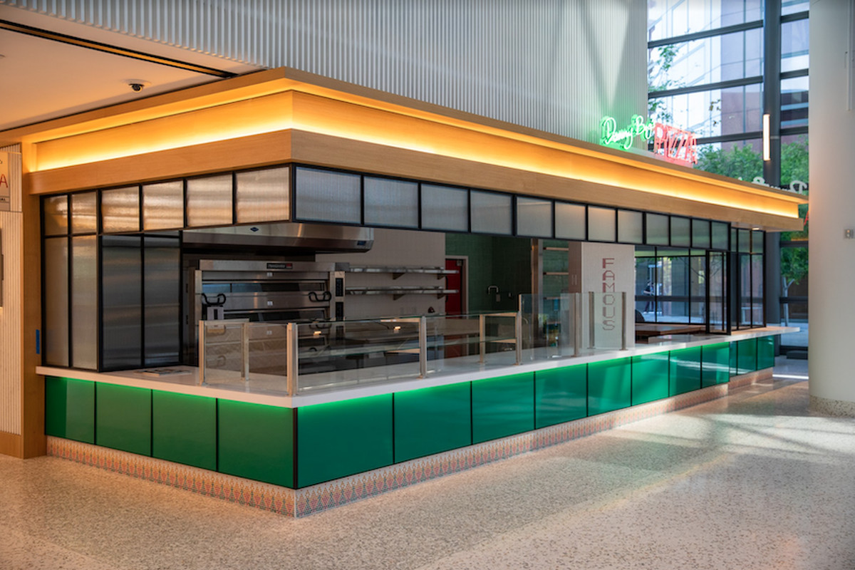A rendering of a neon-lit food stand inside of a new hall.