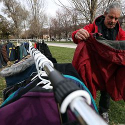 Tovy Rivas looks at coats at the 10th annual Community Coat Exchange at Pioneer Park in Salt Lake City on Friday, Nov. 28, 2014.