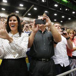 Photos are taken of former presidential candidate and Massachusetts Gov. Mitt Romney at Utah Valley University during commencement in Orem on Thursday, April 30, 2015.