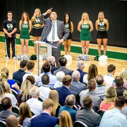 Utah Valley University head basketball coach Mark Pope (center) speaks during a ribbon cutting ceremony during the opening of the Nuvi Basketball Center on the UVU campus in Orem, Utah on Sept. 13.