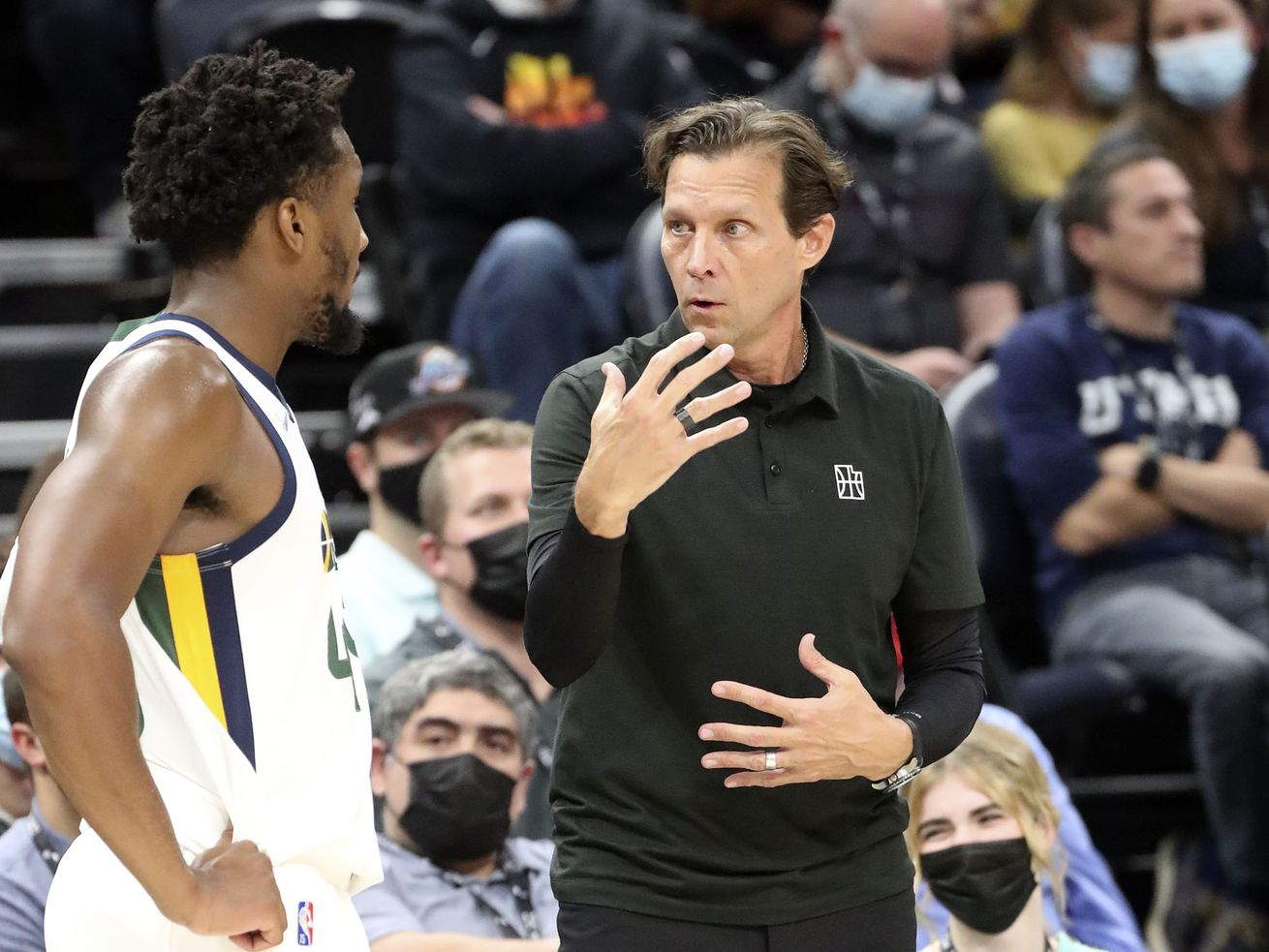Utah Jazz guard Donovan Mitchell (45) listens to coach Quin Snyder during an preseason game against the New Orleans Pelicans.
