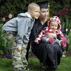 Rachael Echols poses with her nephew Kaden and niece Makenna Heers after graduation. LDS Business College's 125th Commencement in the Tabernacle on Temple Square in downtown Salt Lake City Friday, April 13, 2012.