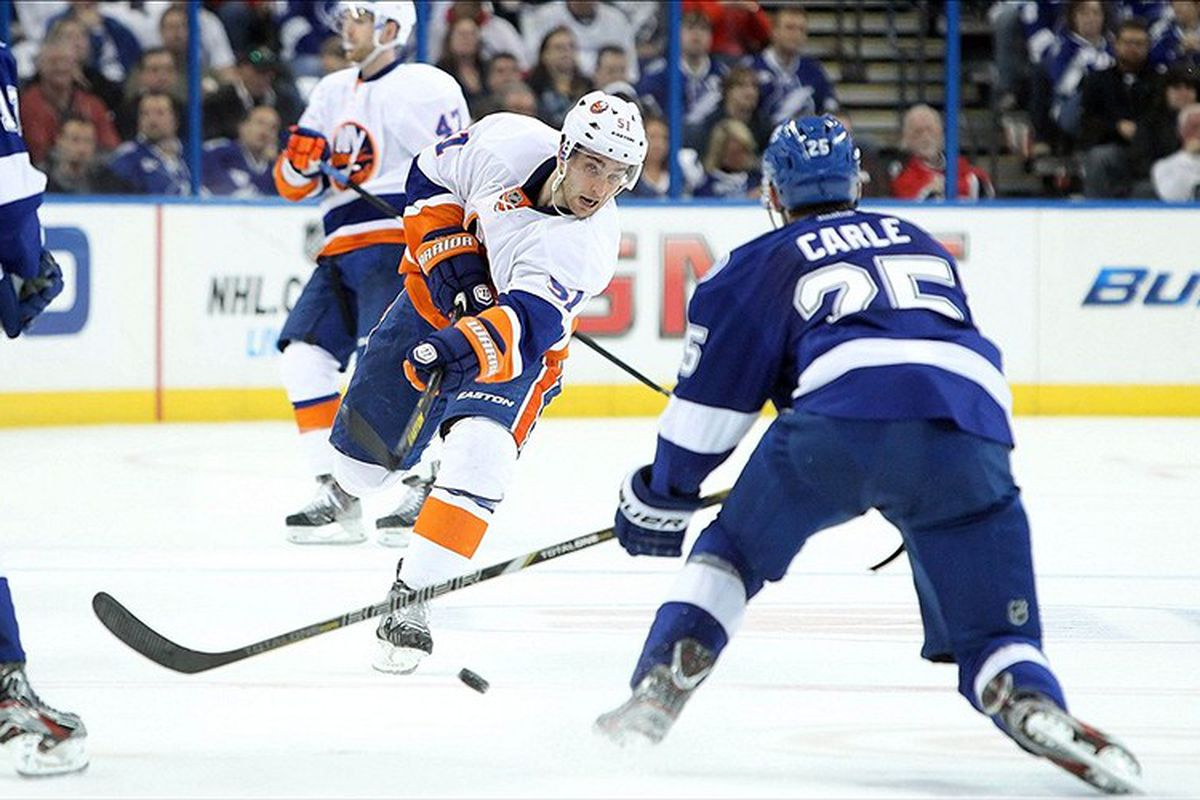 The Lightning's Matt Carle defends against the Islanders' Frans Nielsen during Thursday's 2-0 loss at the Tampa Bay Times Forum