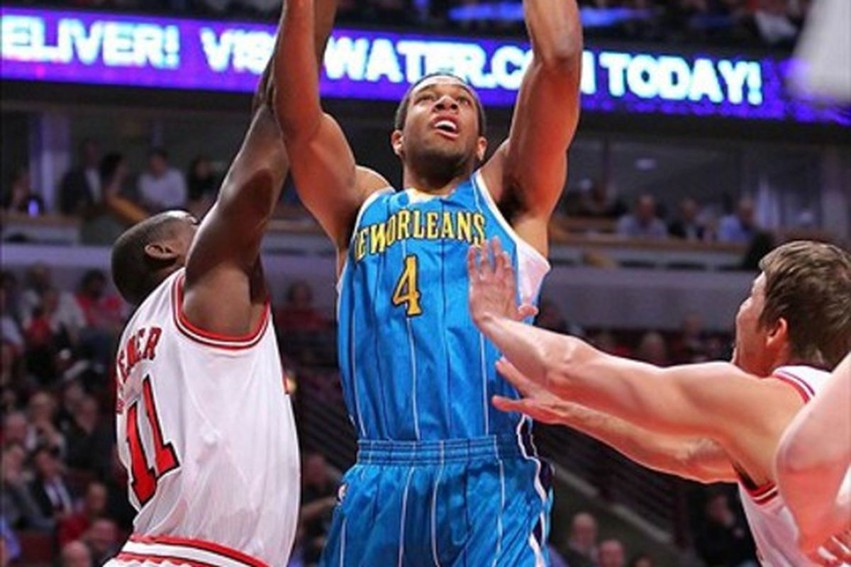 Feb 28, 2012; Chicago, IL, USA; New Orleans Hornets shooting guard Xavier Henry (4) shoots over Chicago Bulls shooting guard Ronnie Brewer (11) during the first half at the United Center. Mandatory Credit: Dennis Wierzbicki-US PRESSWIRE