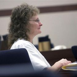 Debra Brown sits at the defense table in Judge Michael DiReda's 2nd District Court in Ogden Jan. 18, 2011. She was the first Utah inmate to try a new state law that allows for non DNA innocence claims. A judge ruled Monday that she is innocent of the crime.