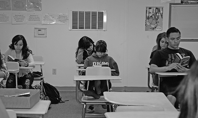 Students at the Chaves Huerta K-12 Preparatory Academy, a charter school, read at the beginning of class. Pueblo parents don't appear to be interested in taking advantage of the city's two high-performing middle schools.