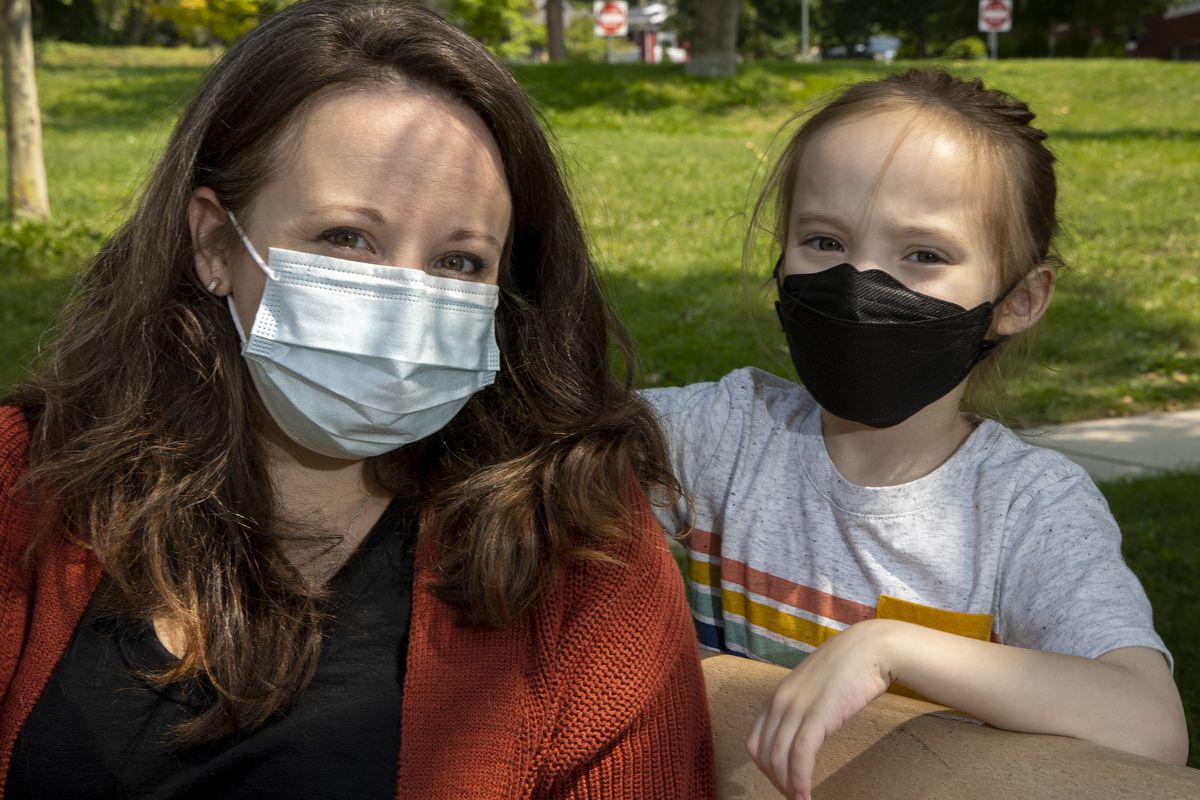 Ashley Weitz, who is among a group of parent plaintiffs who are calling into question the constitutionality of laws limiting schools' capacity to safely serve students during an ongoing pandemic, poses for photos with son Ezra, 7, in Salt Lake City on Friday, Aug. 20, 2021.