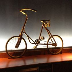 An antique bike sits on the bar, but will live somewhere else in Found