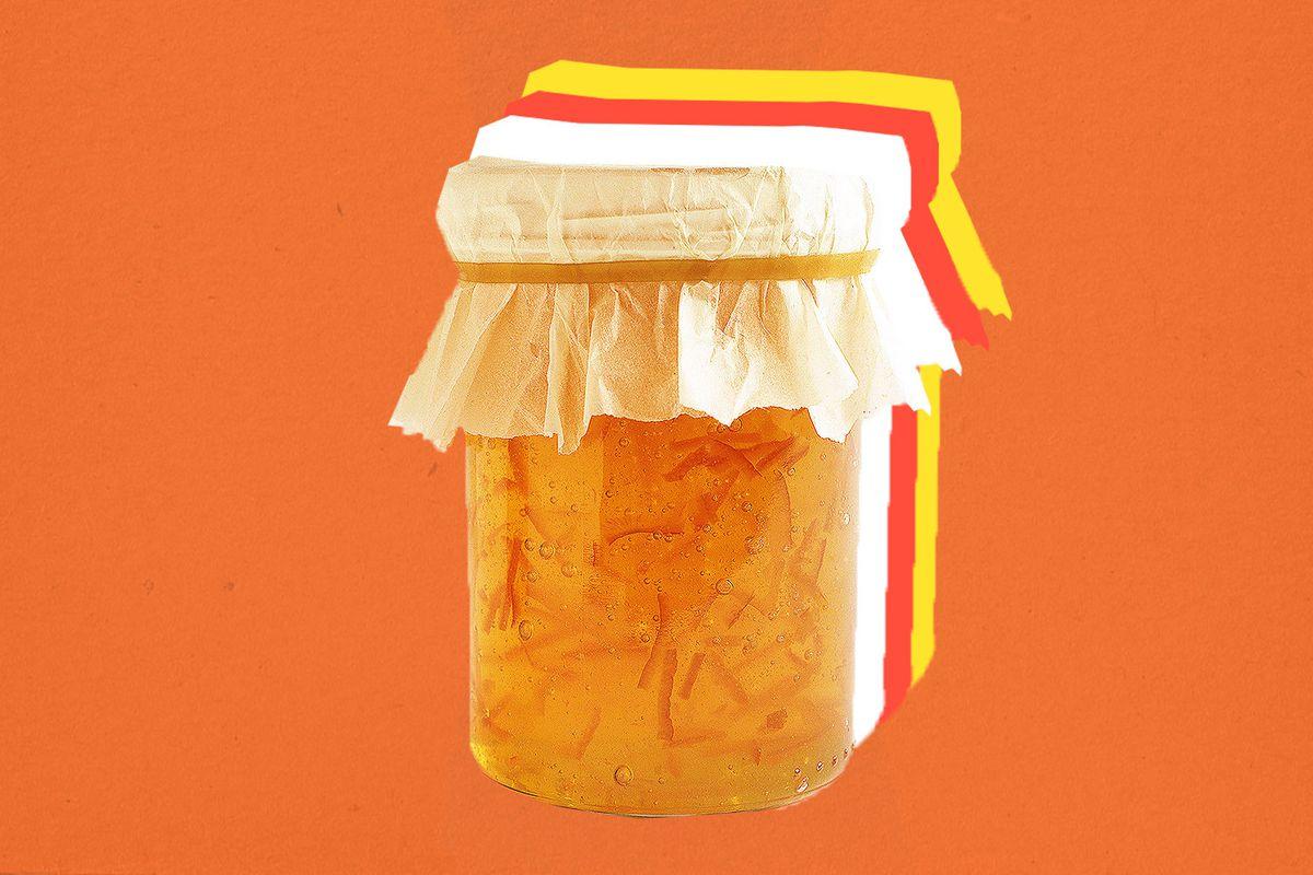 A jar of marmalade on an orange background