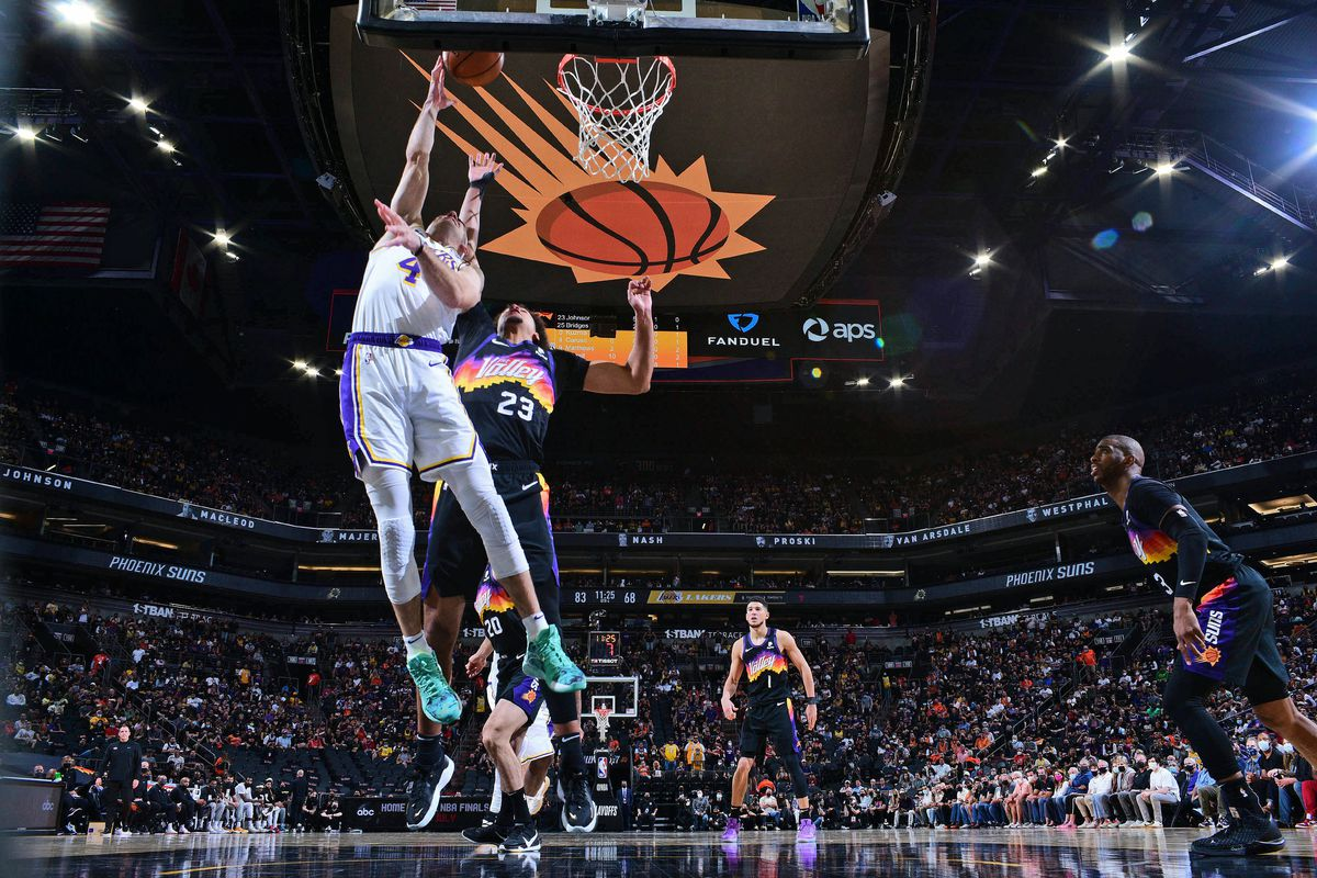 Alex Caruso #4 of the Los Angeles Lakers drives to the basket against the Phoenix Suns during Round 1, Game 1 of the 2021 NBA Playoffs on May 23, 2021 at Phoenix Suns Arena in Phoenix, Arizona.