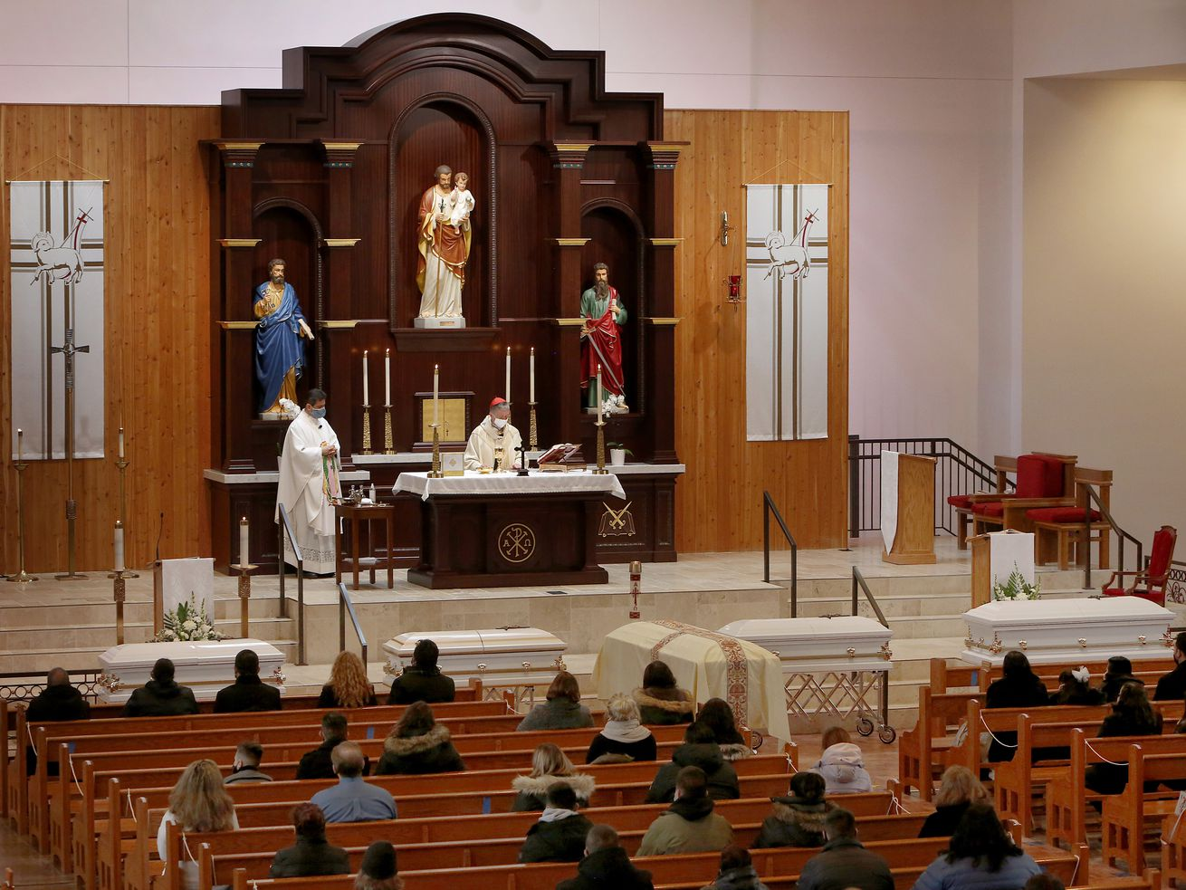 Cardinal Blase Cupich and the Rev. Esequiel Sanchez presided over the funeral Mass of five members of the Espinosa family Wednesday at the Shrine of Our Lady of Guadalupe in Des Plaines.