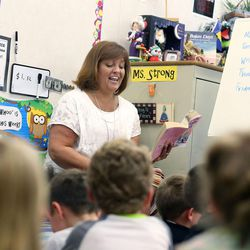 First-grade teacher Chris Strong reads to her students at South Jordan Elementary School on Wednesday, June 8, 2016.