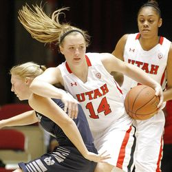 Utah's Paige Crozon spins away from the defense as Utah and Utah State play , in the Huntsman Center.