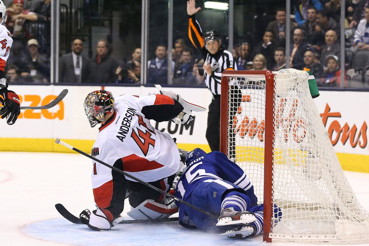 In absence of puck, Joakim Lindstrom attempts to put himself into the net.