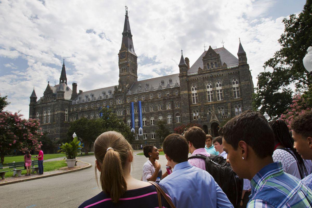 Prospective students tour Georgetown University's campus in Washington. | AP photo
