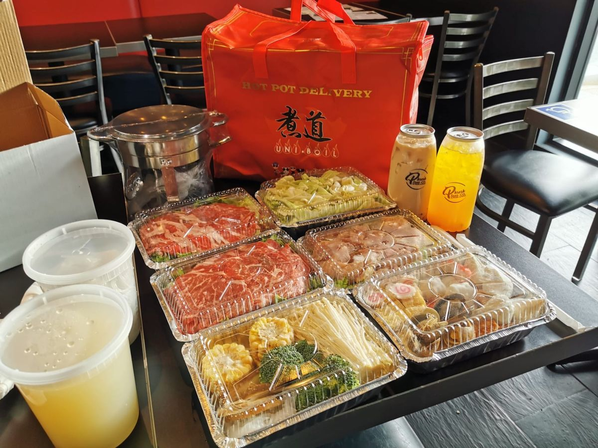 Hot pot takeout from Uniboil in various takeout containers