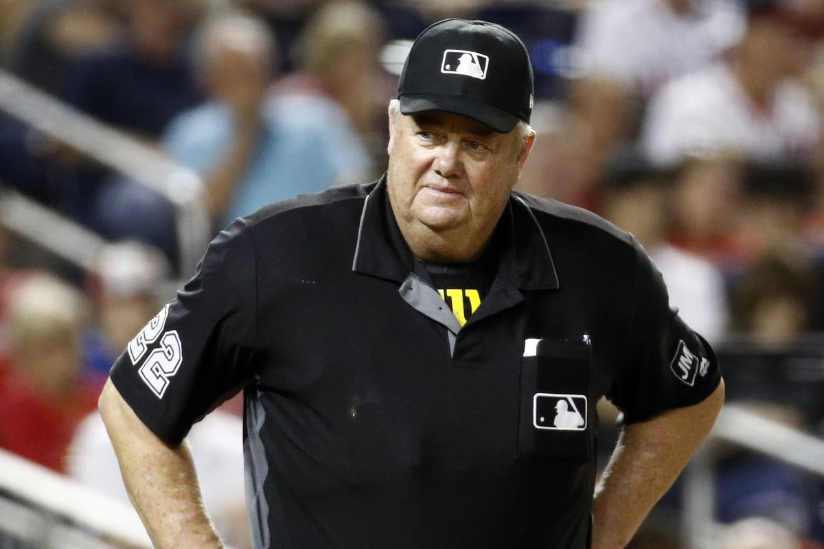 Major league umpire West was awarded $500,000 in damages plus interest dating to July 8 in a defamation lawsuit against former All-Star catcher Paul Lo Duca.