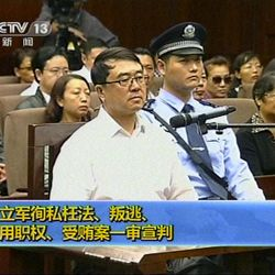 In this Sept. 24, 2012 video image taken from CCTV, Wang Lijun sits in the Intermediate People's Court during his trial in Chengdu, in southwestern China's Sichuan province.  The Chinese police chief whose thwarted defection exposed murder and infighting in high places was sentenced to 15 years in prison Monday, setting the stage for China's leadership to close out the divisive scandal and move ahead with a generational handover of power.