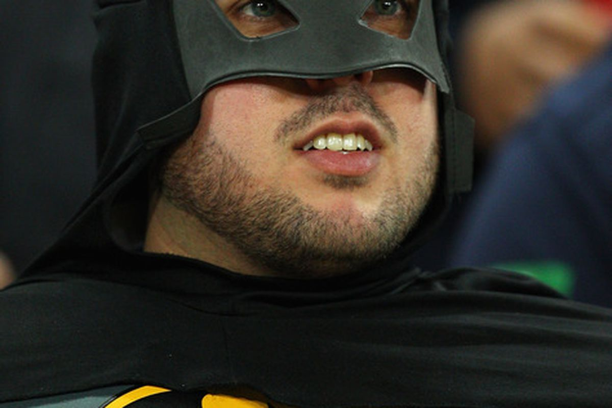 """July 20, 2012 - An area Batman fan stands outside the Broadway Mall movie theater in Hicksville waiting for Nassau County Executive Ed Mangano to decide where he and other lawmakers will see """"The Dark Knight Rises."""""""