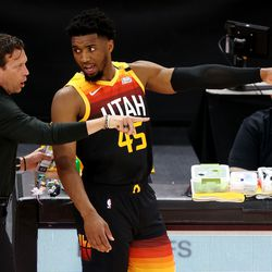 Utah Jazz head coach Quin Snyder talks with Utah Jazz guard Donovan Mitchell (45) as the Utah Jazz and Memphis Grizzlies play Game 2 of their NBA playoffs first round series at Vivint Arena in Salt Lake City on Wednesday, May 26, 2021.