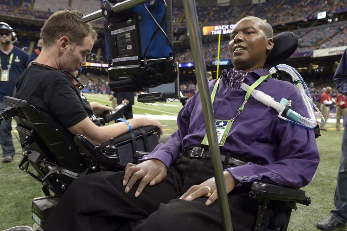 O.J. Brigance (right) speaks with Steve Gleason at Super Bowl XLVII. Both have been diagnosed with ALS.