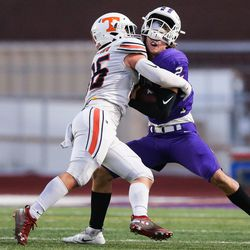 Lehi's quarterback Creyton Cooper (12) is sacked by Timpview's Cael Richardson (36) during a high school football game at Lehi High School in Lehi on Friday, Sept. 25, 2020.