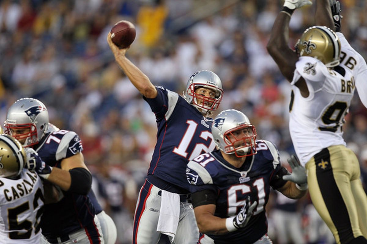 FOXBORO MA - AUGUST 12: Tom Brady # 12 of the New England Patriots throws a pass during the preseason game against the New Orleans Saints at Gillette Stadium on August 12 2010 in Foxboro Massachusetts. (Photo by Jim Rogash/Getty Images)