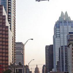 The Space Shuttle Endeavour is ferried by over downtown Austin, Texas, early Thursday.