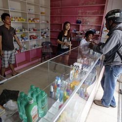 A pharmacy opens in Tacloban, Friday, Nov. 22, 2013.