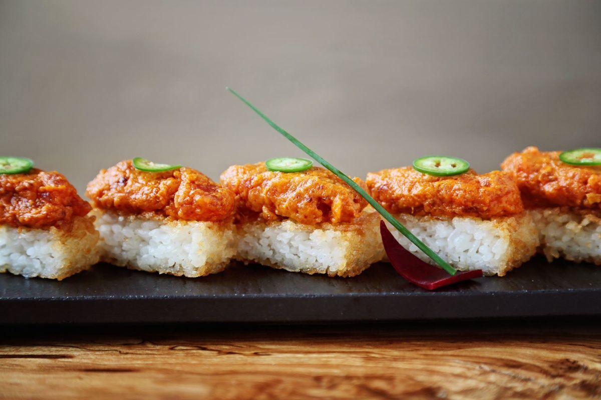 A row of spicy tuna crispy rice at Umi in buckhead