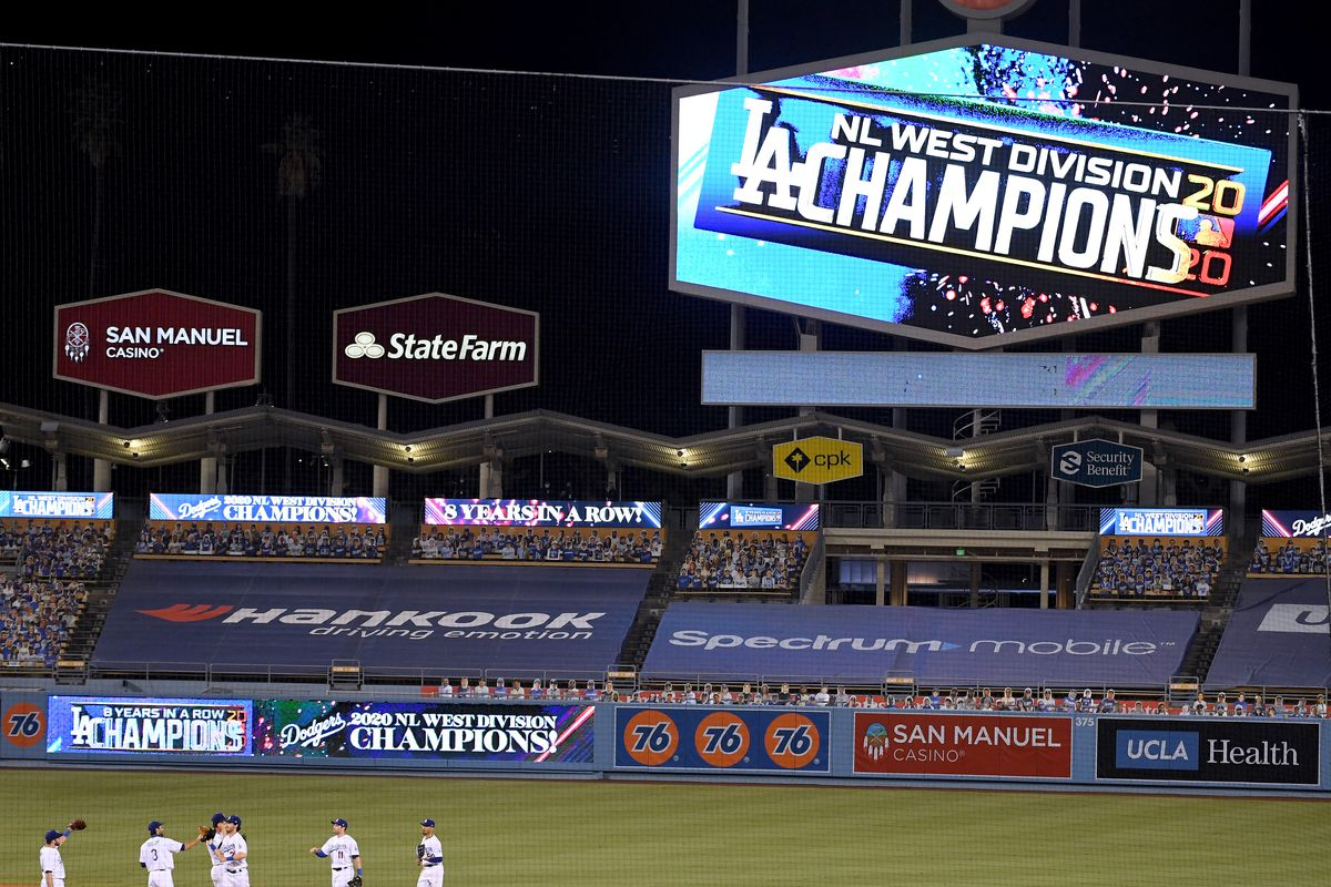 The Los Angeles Dodgers celebrate a 7-2 win over the Oakland Athletics to win the National League West Division at Dodger Stadium on September 22, 2020 in Los Angeles, California.