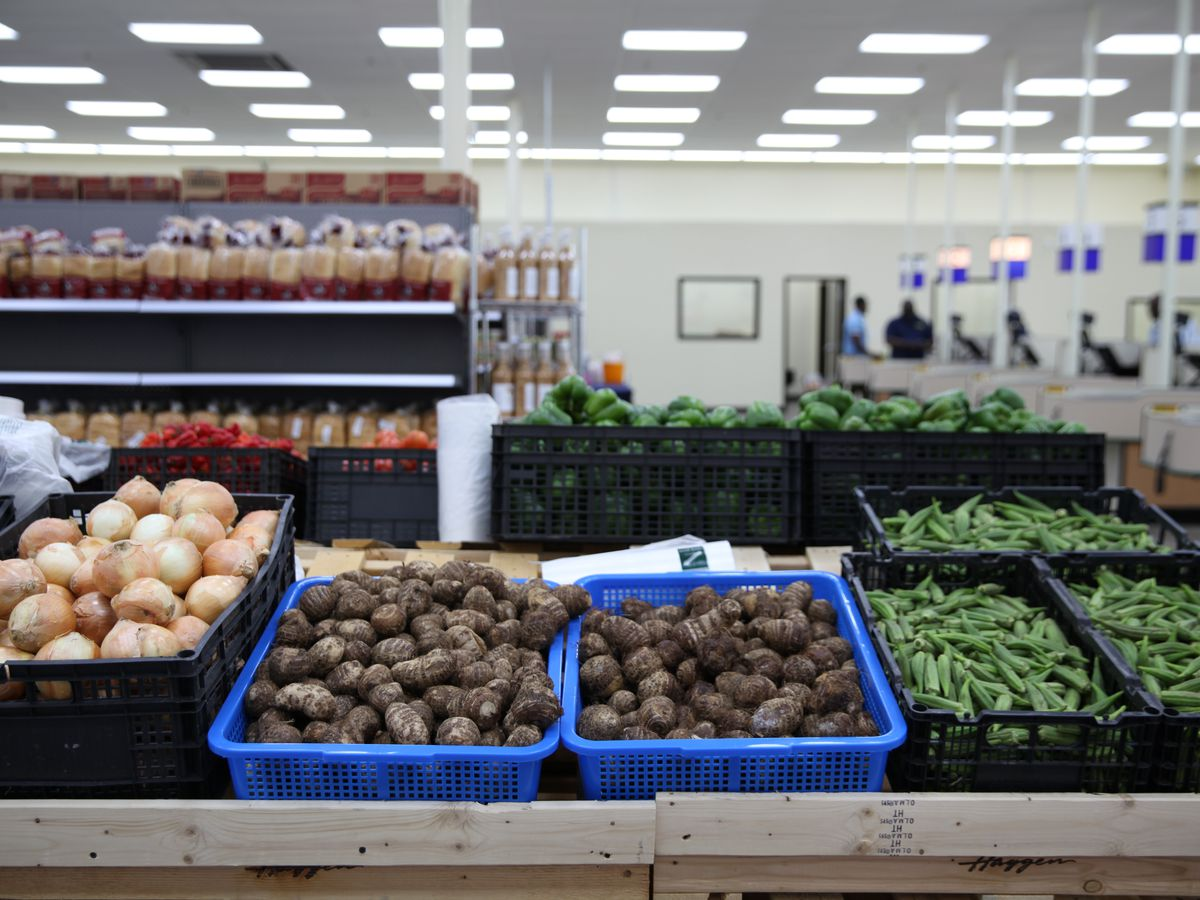 A row of vegetables in the produce section inside the market.