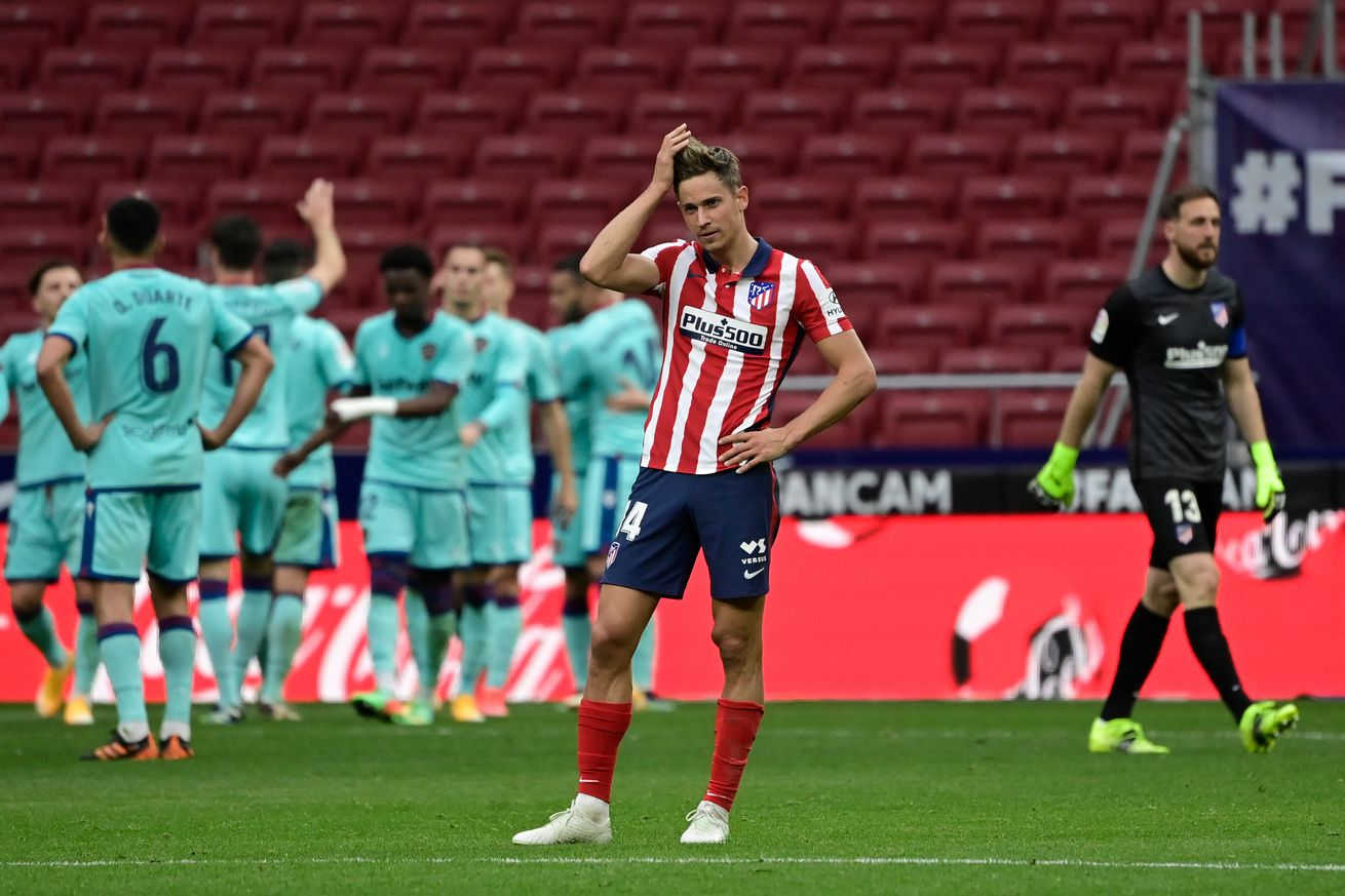 Atletico stumble offers Barcelona title hope