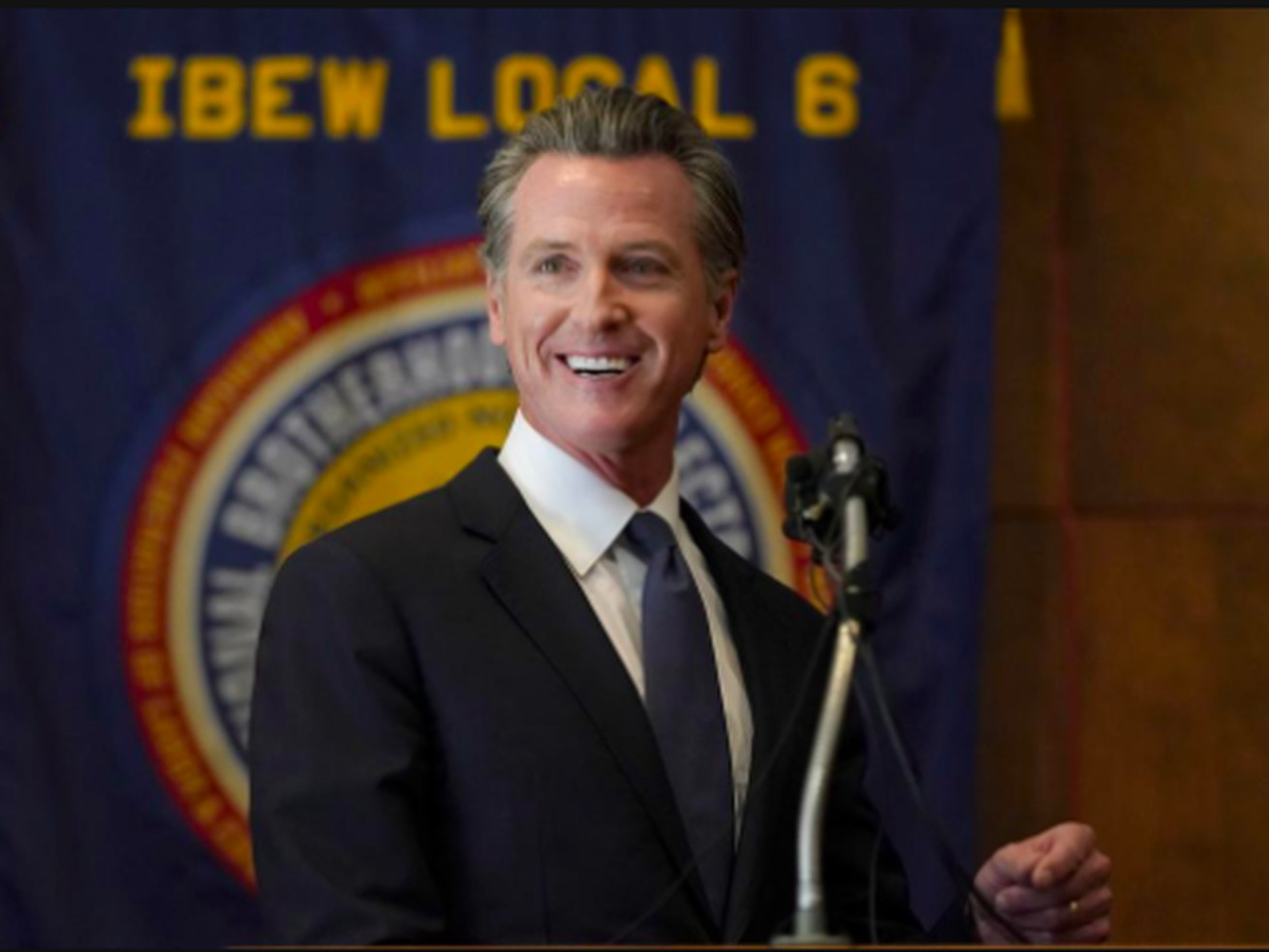 Gov. Gavin Newsom speaks to volunteers in San Francisco on Tuesday, Sept. 14, 2021.