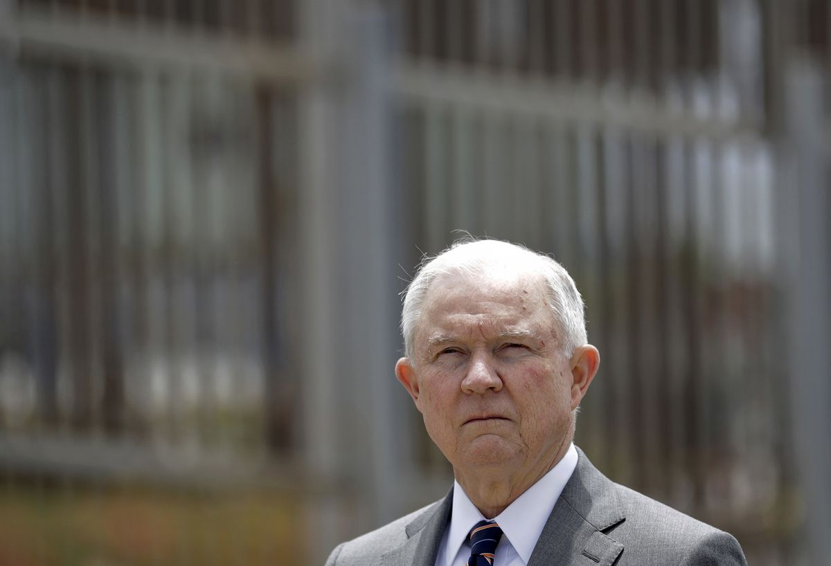 In this May 7, 2018 file photo, Attorney General Jeff Sessions listens during a news conference in San Diego near the border with Tijuana, Mexico. California will introduce group trials on Monday, July 9, 2018. California was a lone holdout and the Justic