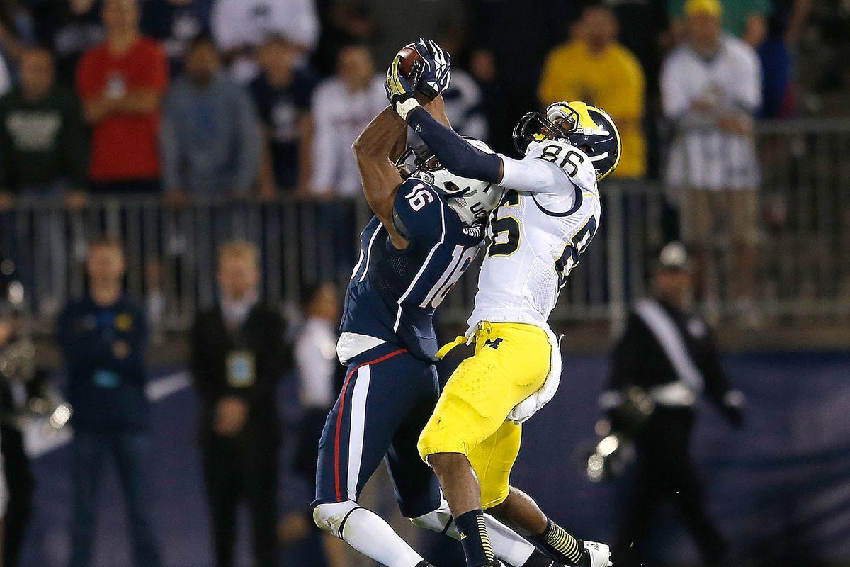 UConn cornerback Byron Jones intercepts Michigan quarterback Devin Gardner in the second quarter of Michigan's 24-21 win.
