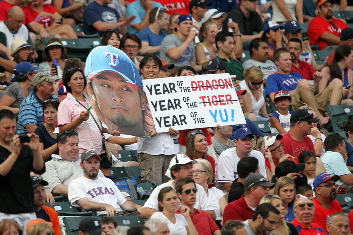 ARLINGTON, TX - JUNE 26: Fans hold up signs of Yu Darvish #11 of the Texas Rangers as he pitches against the Detroit Tigers on June 26, 2012 at the Rangers Ballpark in Arlington, Texas. (Photo by Layne Murdoch/Getty Images)
