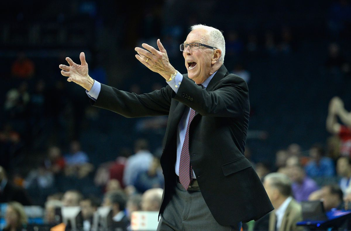 San Diego State Aztecs coach Steve Fisher with his hands up, reacting to a play