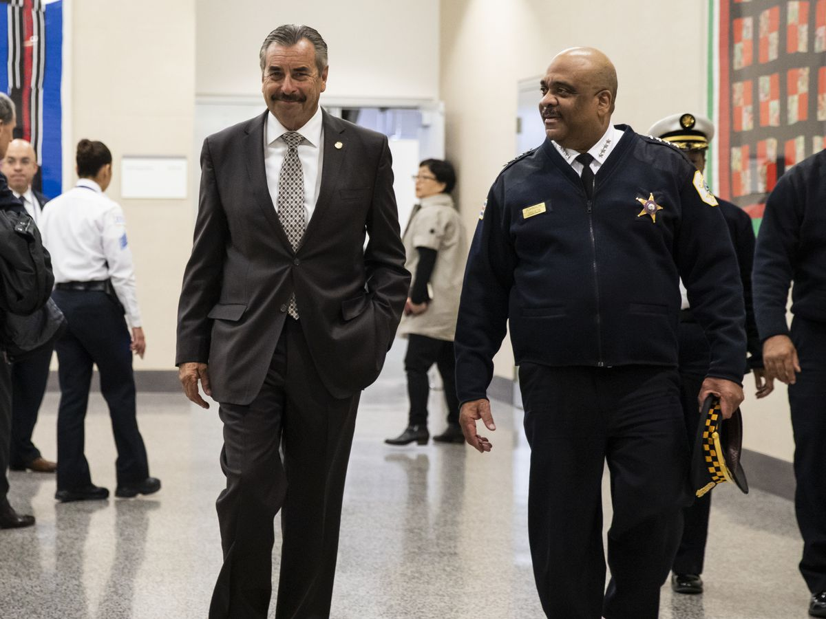 Retiring Chicago Police Supt. Eddie Johnson (right) walks through CPD headquarters with newly-appointed Interim-Supt. Charlie Beck in November 2019.