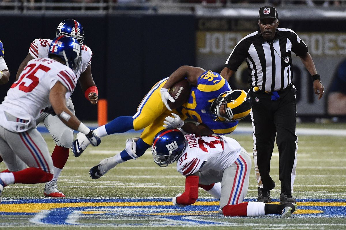 Mike Harris makes a tackle last season against the St. Louis Rams.