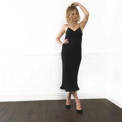A simple black dress is transformed by a pearl hem.