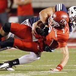 Utah Utes quarterback Travis Wilson (7) is sacked by Brigham Young Cougars linebacker Kyle Van Noy (3) in Salt Lake City  Saturday, Sept. 15, 2012.
