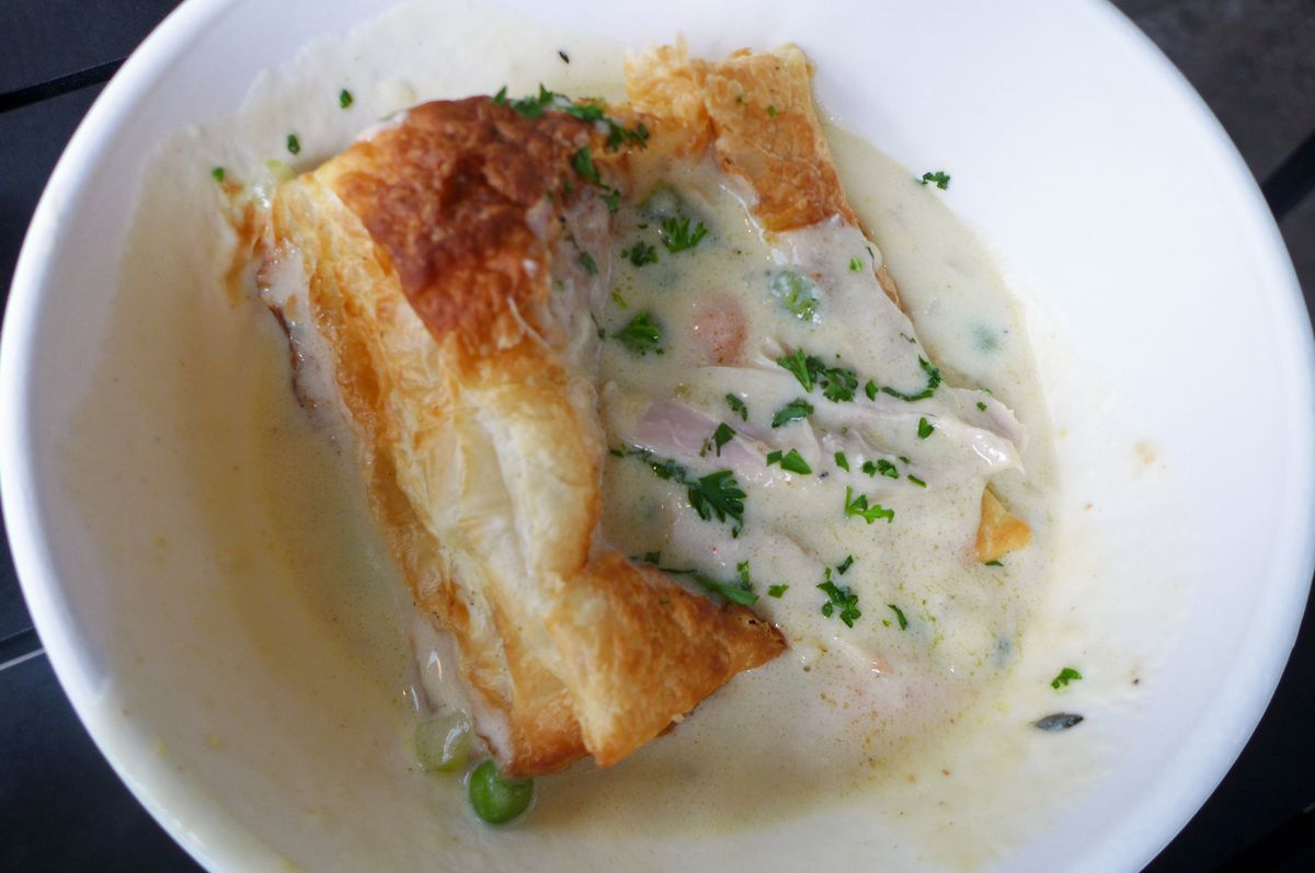 A puff pastry on a river of herbed gravy.