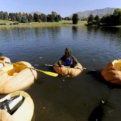 Dan Farr waits around in his pumpkin before the start of the 2013 Mountain Valley Seed Co. Ginormous Pumpkin Regatta at Sugarhouse Park on Saturday, October 19, 2013.